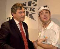 Simon receives his Enterprising Young Brit Award from Gordon Brown in 2004.