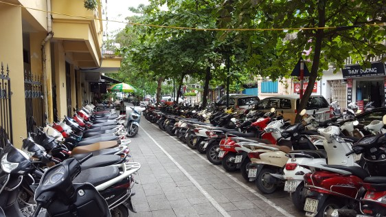 Sidewalk? What sidewalk? This is clearly a motorbike parking lot.