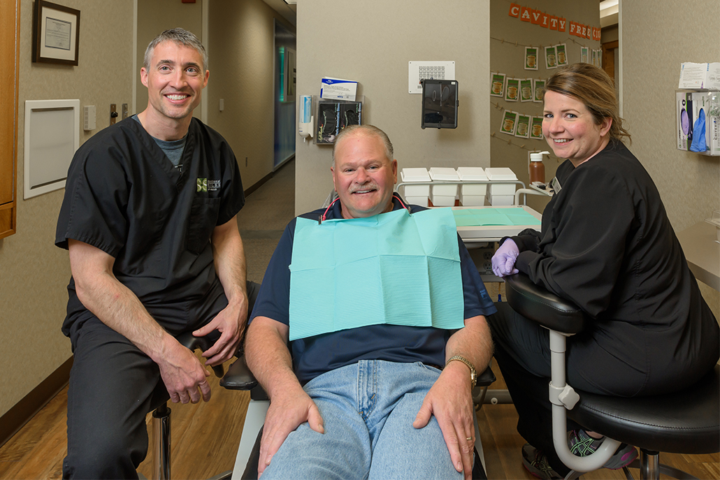 Smiling patient with Sensational Smiles team