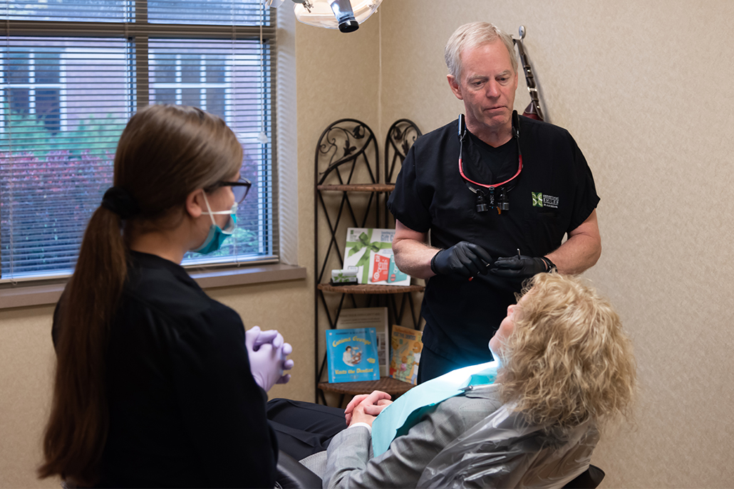 Sensational Smiles team conversing with patient