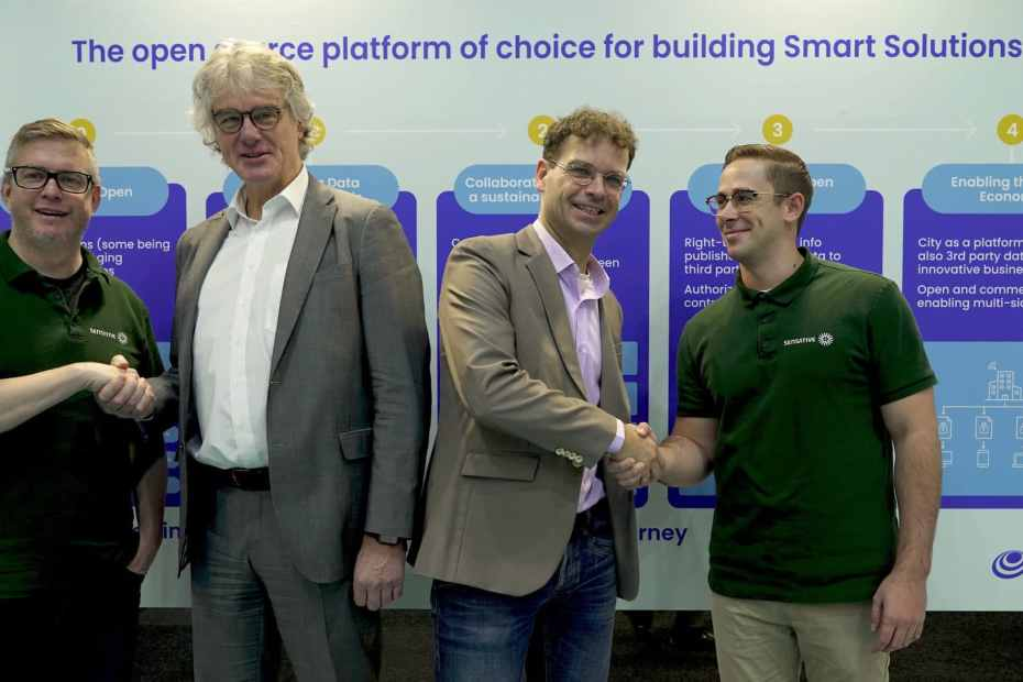 Robert and Morgan from Sensative shaking hands with the left Albert Seubers, Director Global Strategy IT in Cities, Atos and FIWARE Foundation CEO, Ulrich Ahle