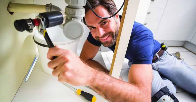 plumber w drip under the sink