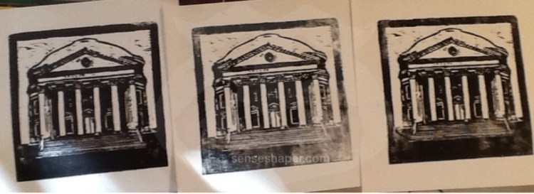 "Woodcut prints of ""The University of Virginia's (UVA) Rotunda"" from whiteboard woodblock. The print was too large to get a high quality scan, so, for now, you will have to make due with this shot showing the print variations."