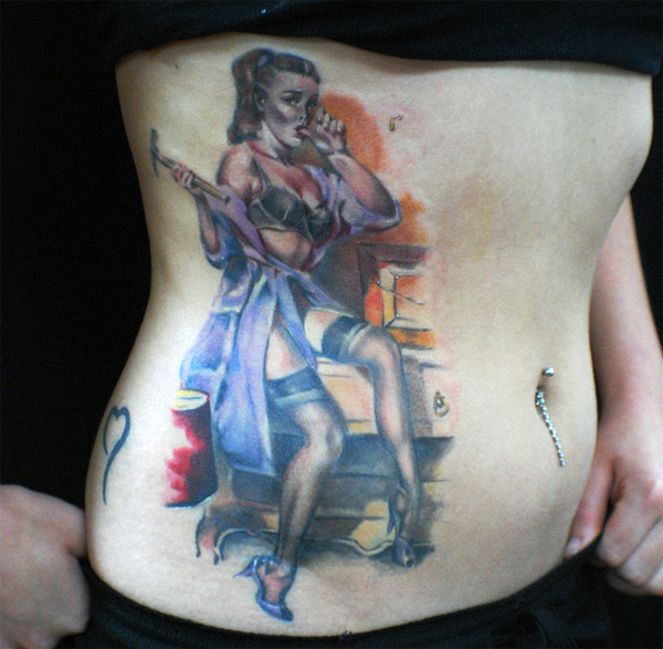 Here's an excellent pinup girl tattoo done on a girl's ribcage,