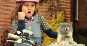 little-girl-and-cat-sing-british-advert
