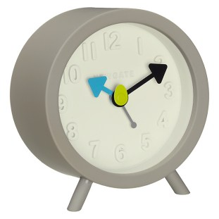 A Grey And White Alarm Clock With Blue And Black Hands