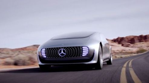 A Picture Of The Mercedes Benz F 015 Luxury in Motion Driving Down A Road