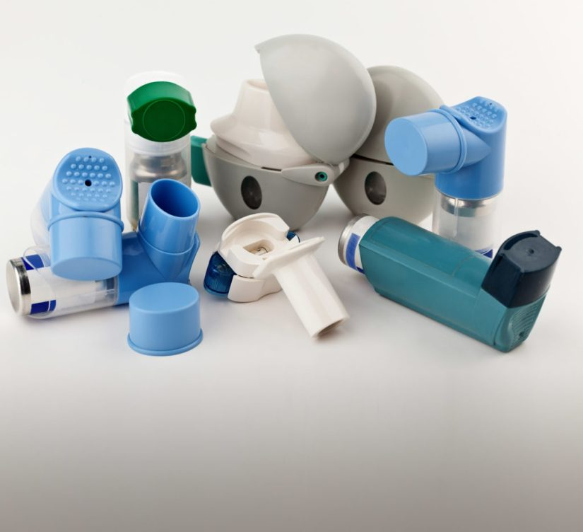 A photograph of a group of different types of salbutamol inhalers. The asthmatic lungs show that the bronchial tube of the lungs is inflamed, therefore constricting and blocking airflow.