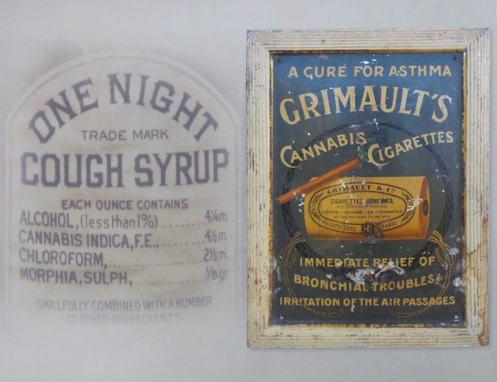 """A photograph showing the labelling of old fashioned Cough Syrup as well as Grimault's cannabis cigarettes. The cough syrup label reads """"One Night Cough Syrup"""" and includes amongst its ingredients: alcohol, cannabis indica, chloroform, and morphia sulph. The Grimault's cannabis cigarette advertisement shows a rolled brown cigarettes, presumably filled with cannabis. Below it reads the copy """"Immediate relief of bronchial troubles irritation of the air passages."""""""