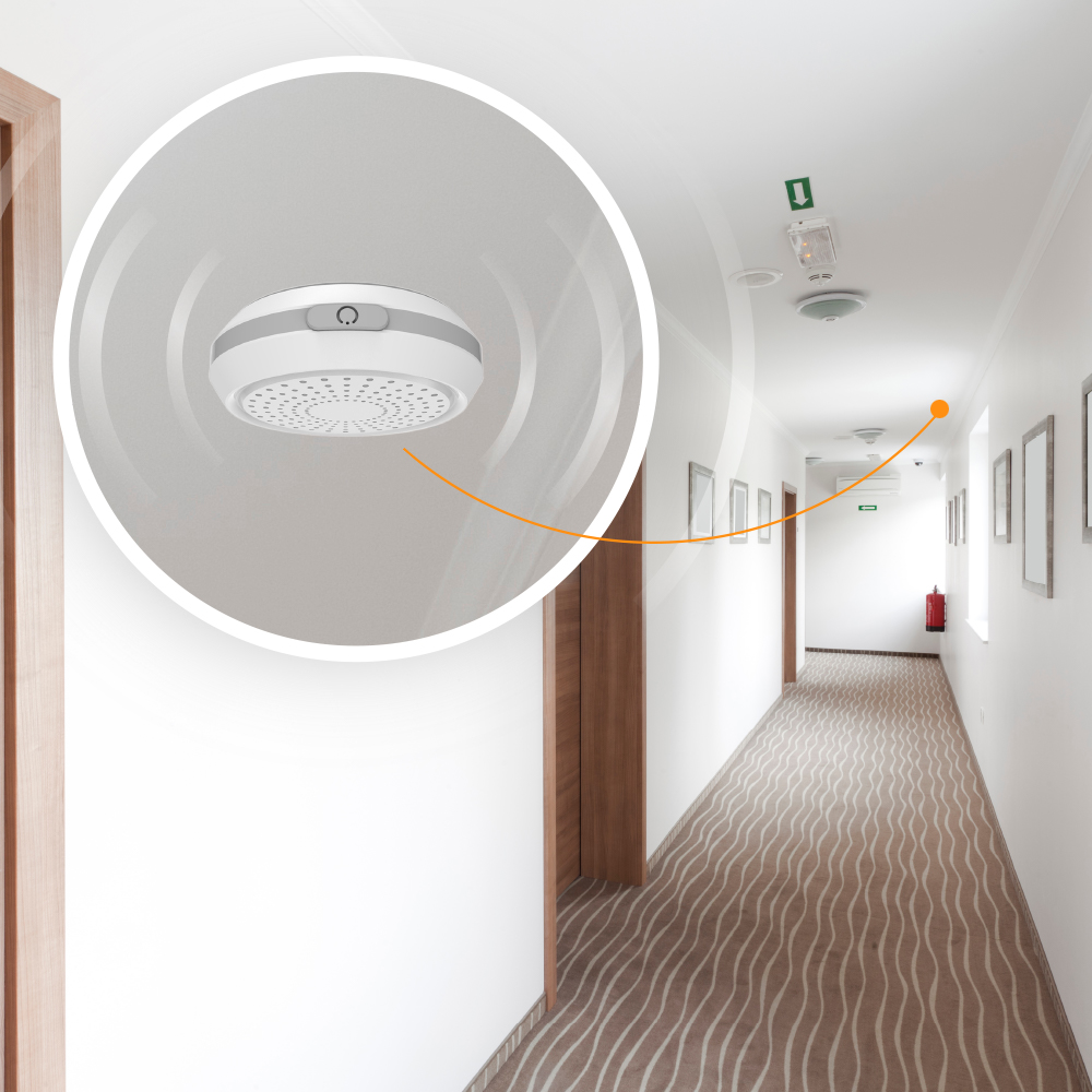 A small beacon installed on a ceiling to for monitoring