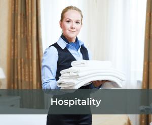 hotel worker folding some linen