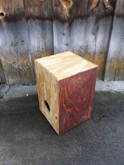 Blood stained cajon with feet and line in