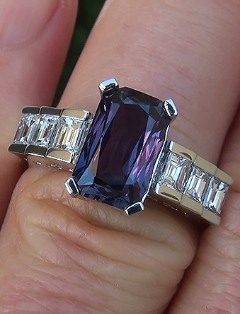 This is a stunning on hand view in direct sunlight that shows the amazing colors in this beautiful sapphire.