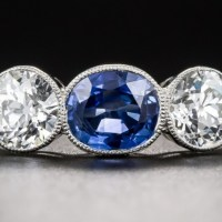 A Stunning Natural Burmese Sapphire and Diamond Three-Stone Ring.