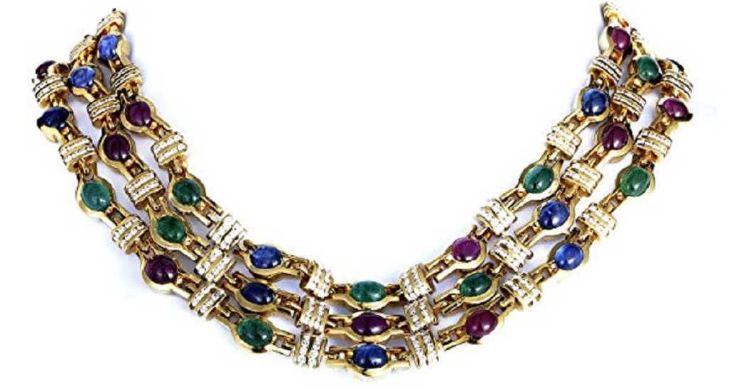 Epitomizing tasteful glamour and lavish luxury in a flamboyant and charming design, this outstanding necklace is made of 18K yellow gold with 6.20 carats of glittering diamonds, 15.00 carats of splendid emeralds, stunning sapphires weighing in total 21.00 carats and romantic rubies totaling 16.00 carats.