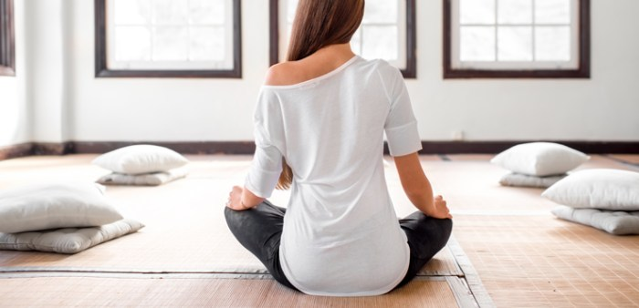 Woman practicing yoga indoors