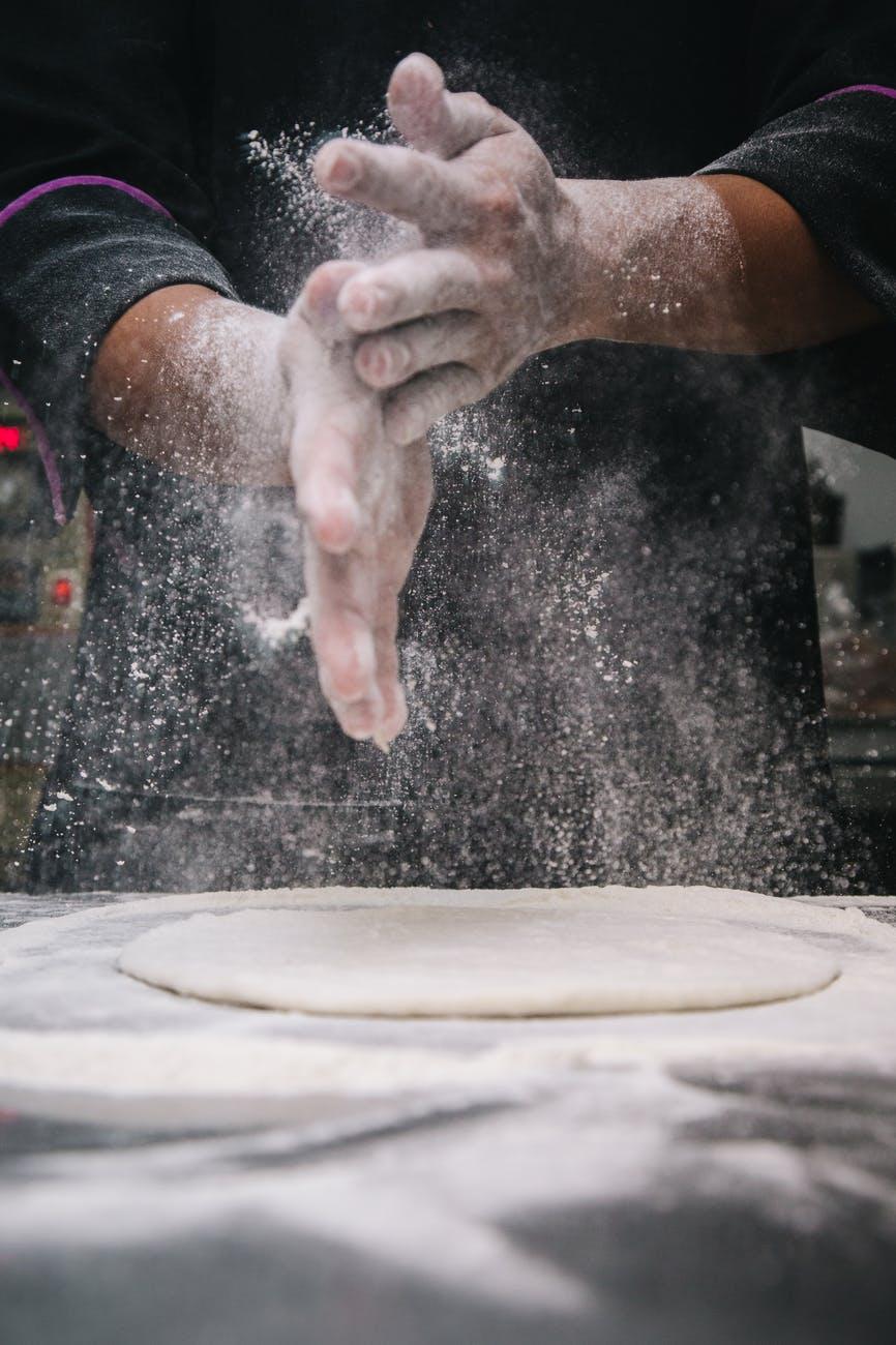 person making dough