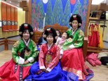 Ward Members dressed up in traditional wear. If you notice our investigators baby is crying in the corner awh!