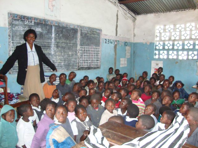 Photo of children and teacher in a Classroom in Naloyela, Western Zambia