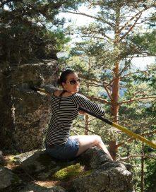 Perched atop a mountain boulder