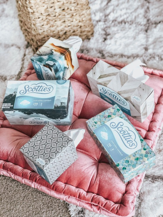 Five Boxes of Scotties Tissues on a Velvet Floor Cushion