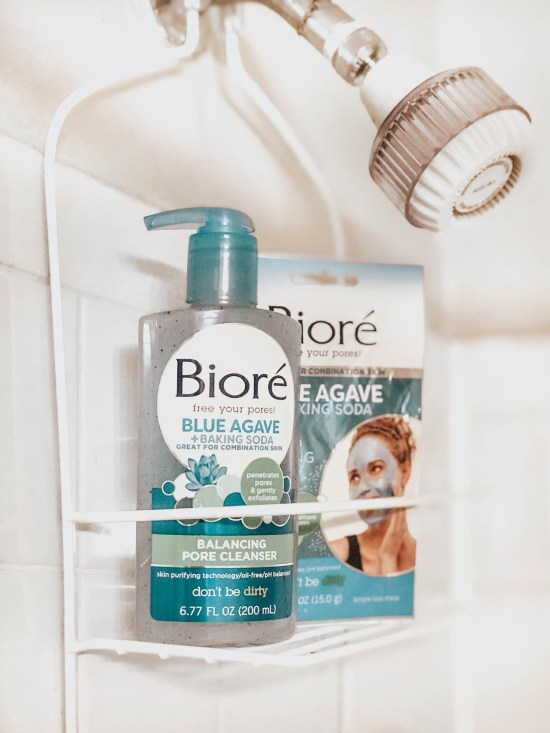 Biore Balancing Pore Cleaner and whipped nourishing mask in shower caddy