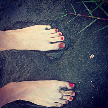 Photo: Sera's feet in dark mud