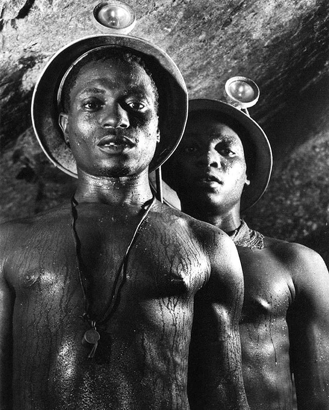 14 - 1950. A pair of miners, wearing helmets and perspiring heavily, Robinson Deep Gold Mine, Johannesburg, South Africa. Photo by Margaret Bourke-White.
