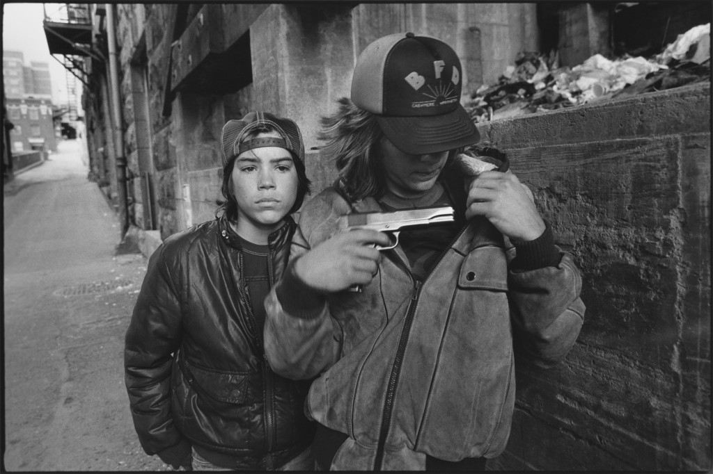 2 - 1983. Rat and Mike with a gun, Seattle, Washington, by Mary Ellen Mark.