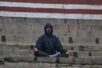 indian man meditating in Varanasi, India