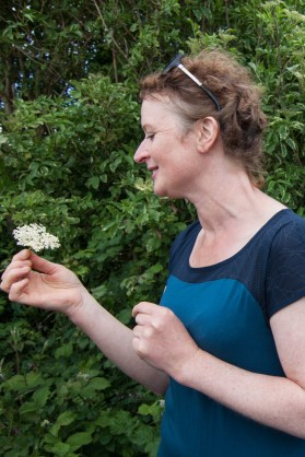Oonagh O'Dwyer of Wild Kitchen stops to smell an elderflower during a foraging tour of the County Clare coastline near Lahinch.