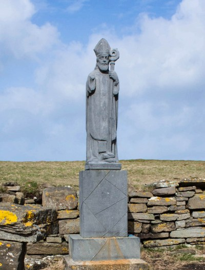 A statue of St Patrick, Ireland's patron saint, marks the remnants of a church he founded at Downpatrick Head in County Mayo.