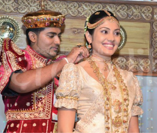 The Groom Ties One More Necklace During The Marriage Ceremony