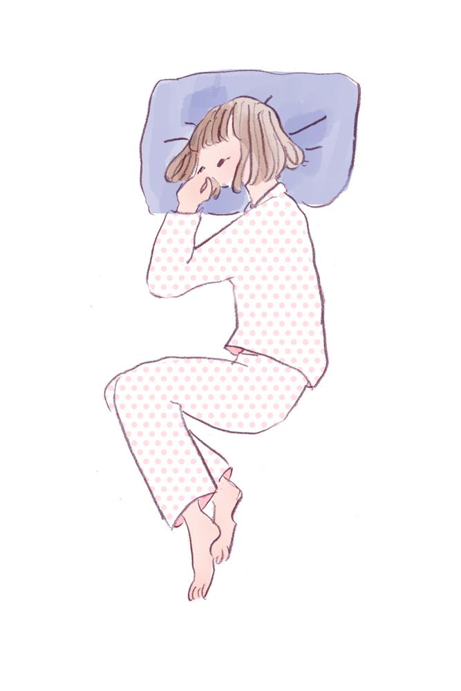 体を丸める寝相