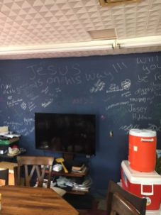 Everyone who comes through is asked to sign the wall, because this place belongs to them.