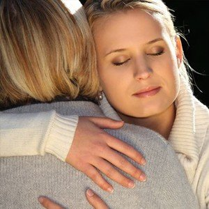 Mom loving teen daughter | Serenity LInks Coaching offers professional life coaching for moms of kids affected by early childhood trauma and its related conditions