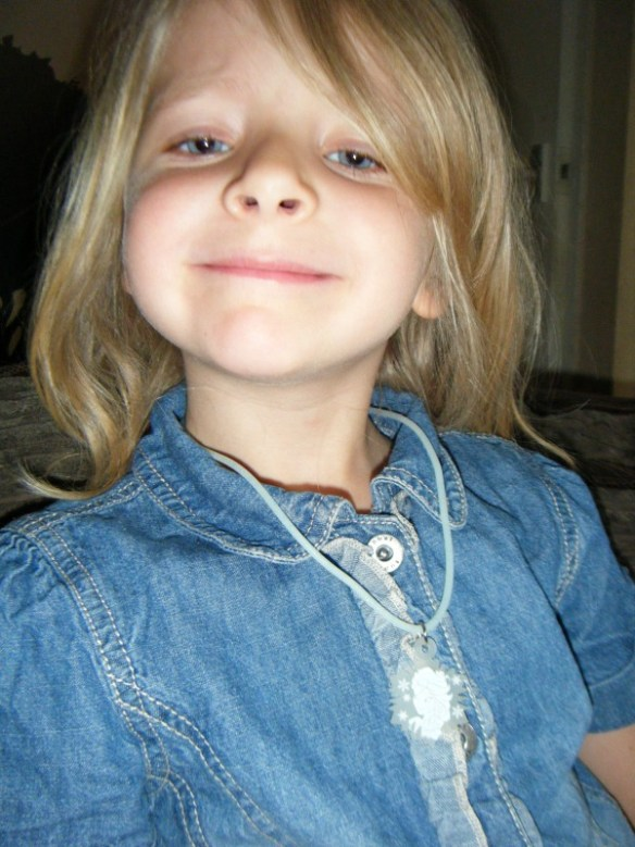 caitlin wearing her frozen necklace
