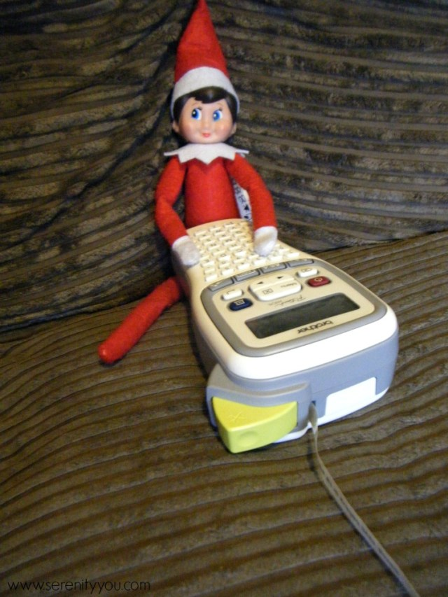 elf on the shelf with label maker
