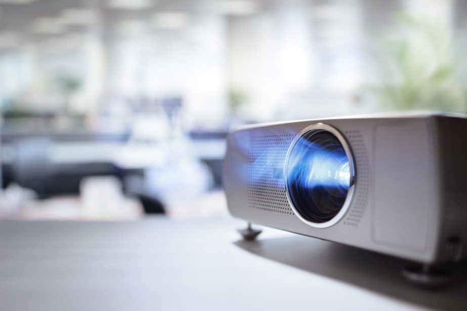 Presentation with lcd video projector in office
