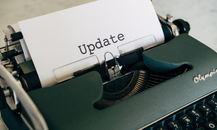 A typewriter with the word update
