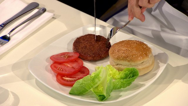 It was smart to sample the first lab-grown burger in England, where there is no existing good food to compare it with.