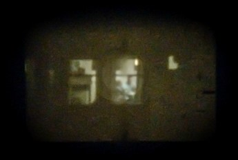 In the window through the viewfinder.