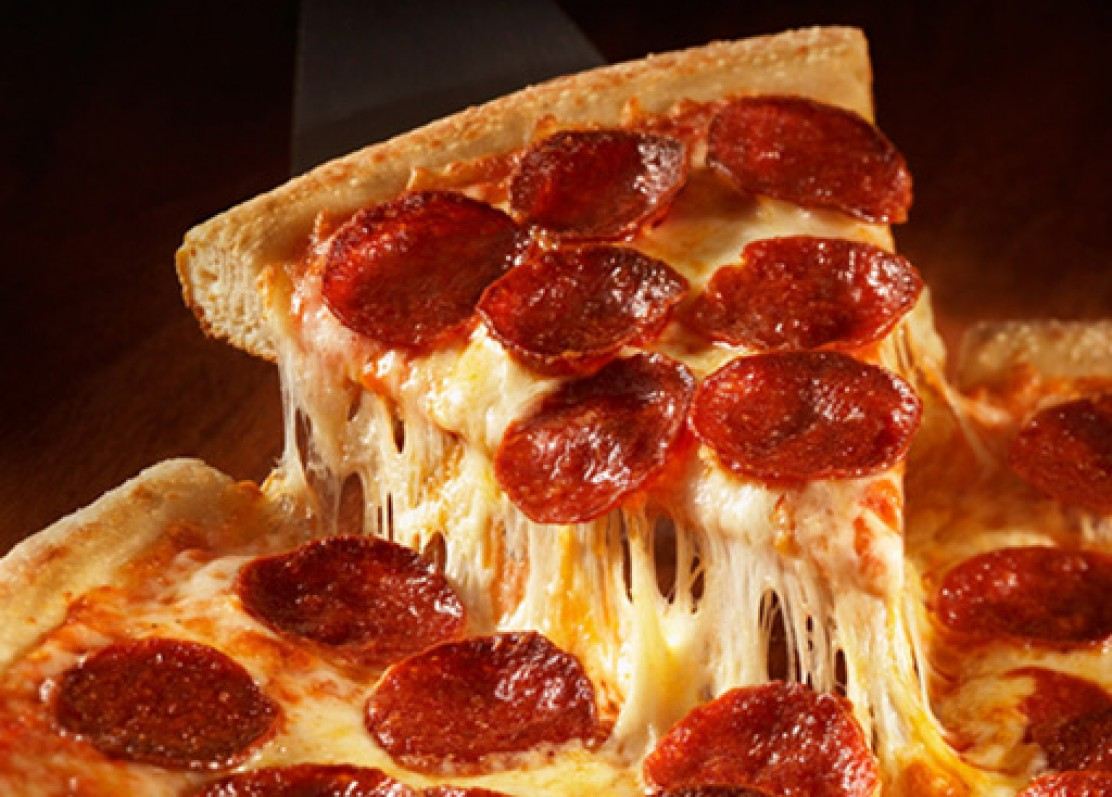 Pizza Near Indiana University of Pennsylvania - Pepperoni pizza slice dripping with cheese