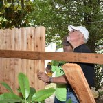 Voluntters put up a new fence at the Love Inc property.