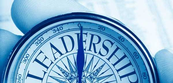 compass leadership true north blue and white in hand background business page newspaper