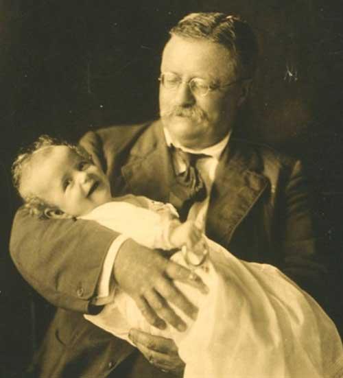 Theodore Roosevelt holding baby www.servetolead.org
