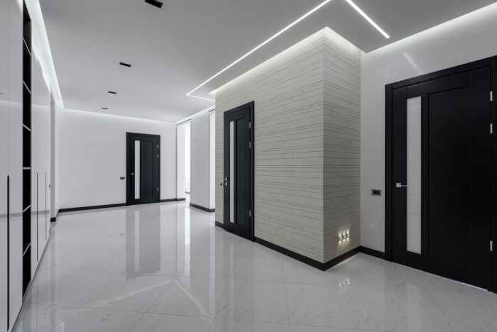 stylish white hall in big apartment building