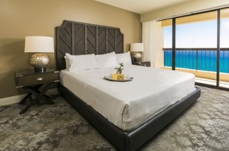 Aston-Waikiki-Beach-Tower-Oceanfront-Master-Bedroom-with-Amenity