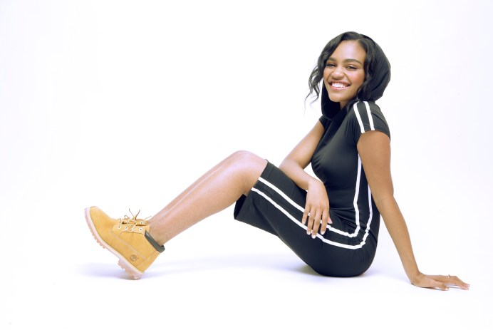 china anne mcclain wearing a black dress with white stripes down the side and Timberland boots