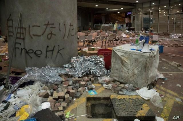 Debris and graffiti are seen inside the Hong Kong Polytechnic University campus, in Hong Kong, Nov. 22, 2019.
